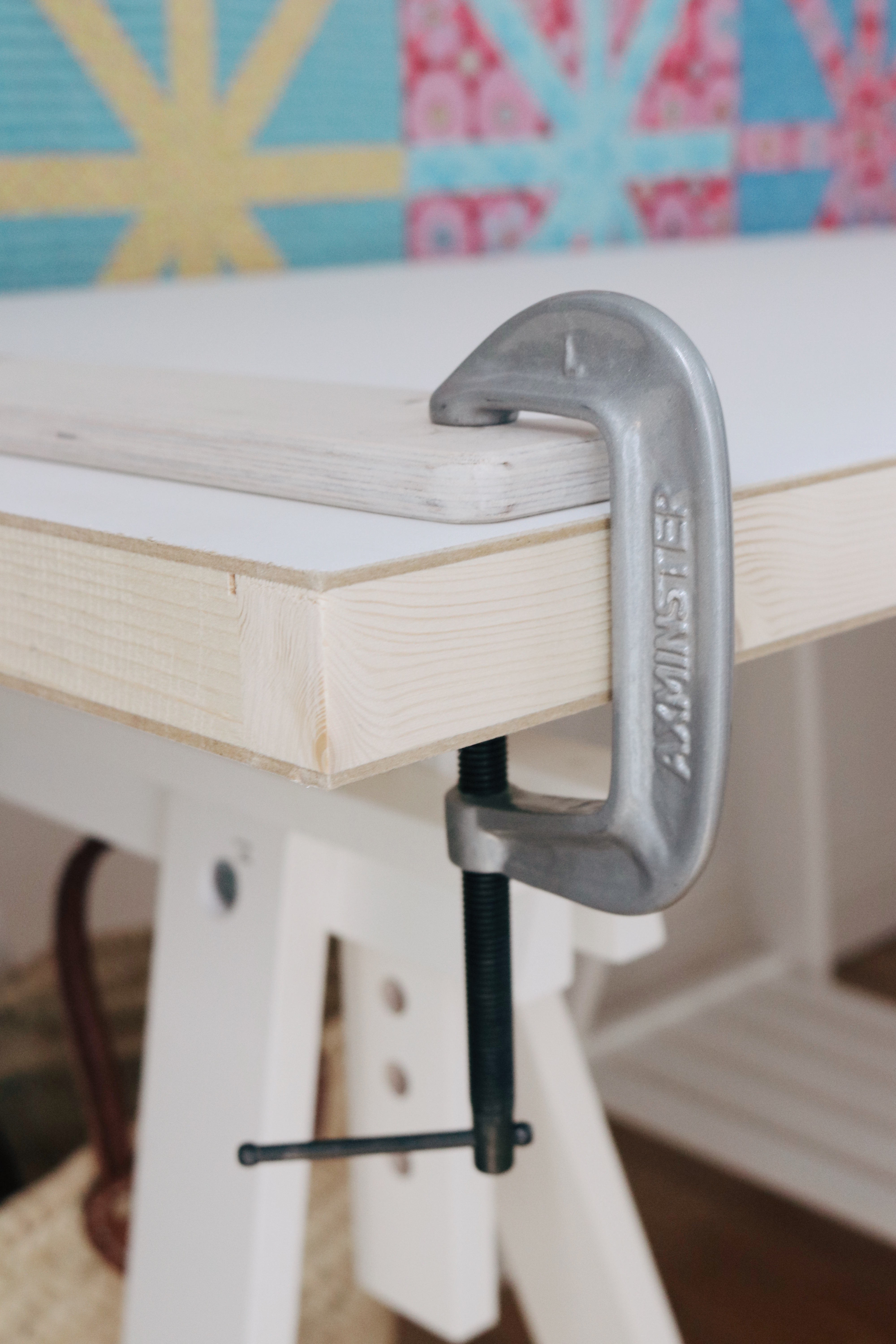 Machine Quilter frames clamp to the table