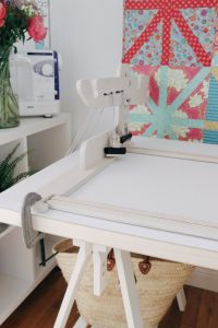 The machine quilter frame clamped to the table