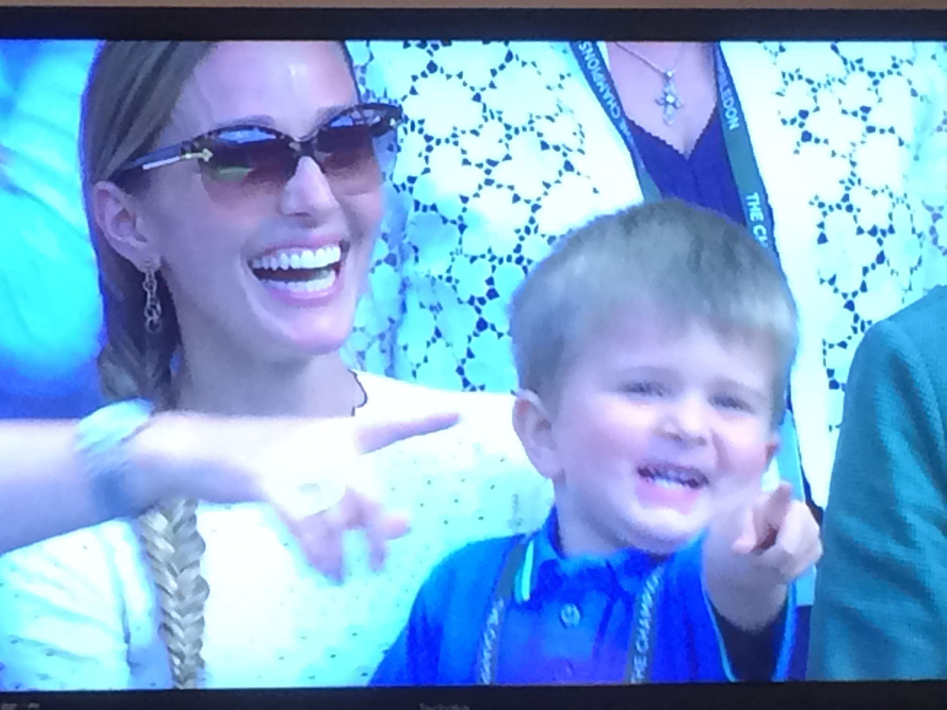 Djokovic's wife and son applauding